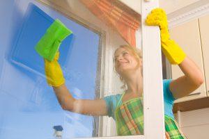 woman cleaning outside of uPVC window