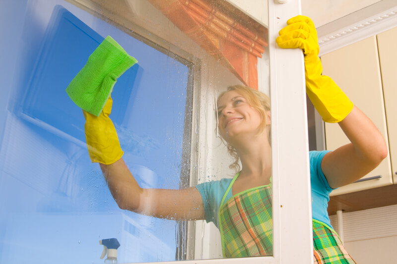 woman cleaning outside of uPVC window