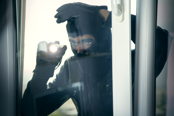 burglar looking in through uPVC window